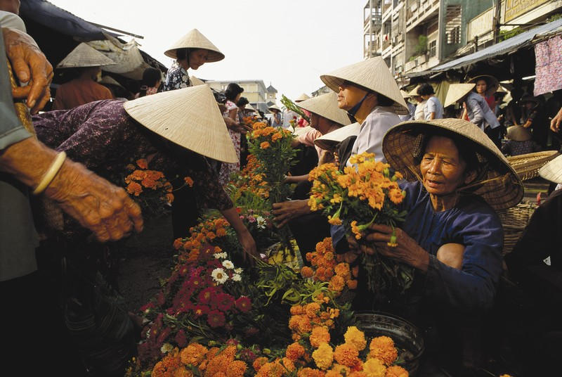 Flowers for the Tet New Year celebrations fill the market at Cantho, the largest town in the Delta.