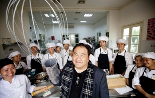 Jimmy Pham, creator of  KOTO (Know One Teach One) poses with a group of his students at their training center in Hanoi, Vietnam.