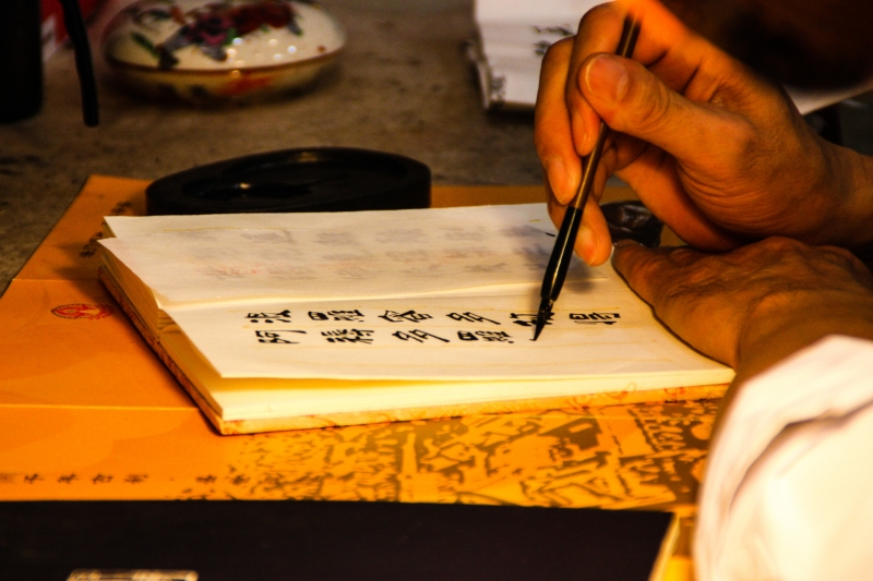 monk-practicing-calligraphy-at-big-wild-goose-pagoda-image-by-james-pham-21