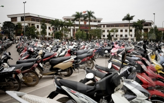 Hundreds of motorbikes are lined up in a parking lot. Hanoi, Vietnam, Asia.