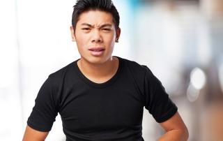 sad chinese-man stomachache