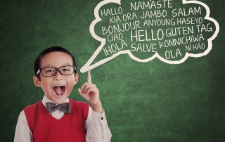 Education concept: schoolboy learn universal language at class