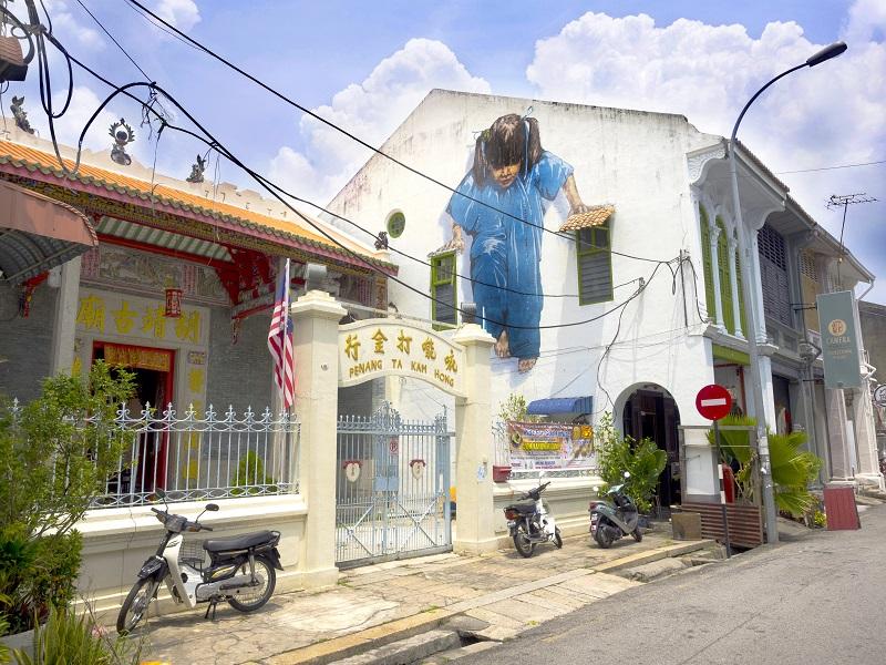 "Georgetown, Penang, Malaysia - April 25, 2014: ""Little Girl in Blue"" street art mural in George Town, Penang, Malaysia."