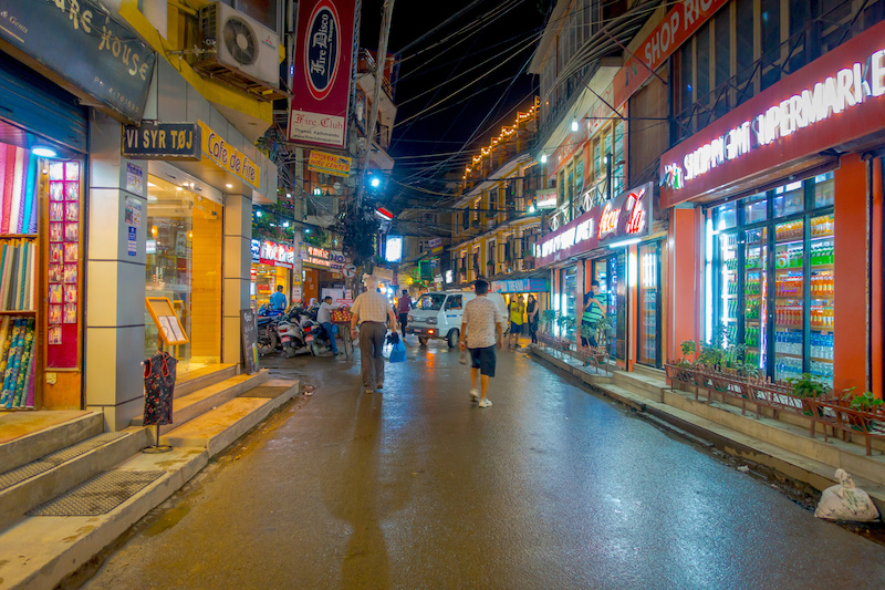 THAMEL, KATHMANDU NEPAL - OCTOBER 02, 2017: Unidentified people walking and buying in the streets at outdoors at night in Thamel. Thamel is a commercial neighbourhood in Kathmandu, the capital of Nepal. One of the popular tourist attraction in Kathmandu.