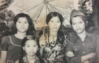 We sent Dad this photo in 1980 when we heard that he was alive. Quang Phuong is wearing Dad's military hat