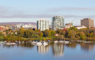 HULL, CANADA: 12TH OCTOBER 2014: A view of boats docked along Ottawa River in the morning. Buildings can also be seen in the background