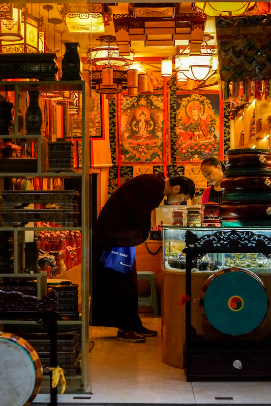 05 - A monk shops in Little Lhasa