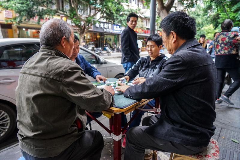 09 - A streetside game of mahjong