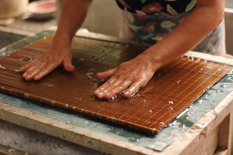 pressing the bamboo screen
