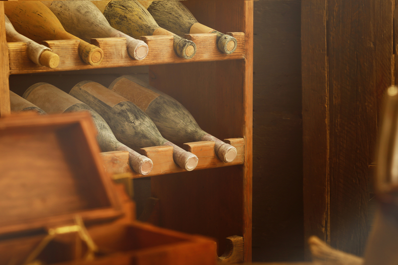 Aged wine bottles in a wine cellar